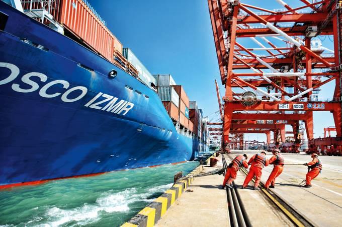 Exportações na China saltam 14,2% em março, mas importações decepcionam
